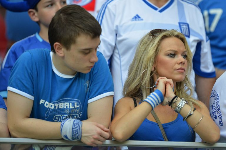 Greek fans wait for the start of the Euro 2012 championships football against Russia